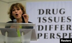 "FILE - Agnes Callamard, a United Nations Special Rapporteur on extrajudicial, summary or arbitrary executions, gestures while delivering a statement during a ""Drug issues, Different Perspectives"" forum at a compound of University of the Philippines in Quezon city, metro Manila, Philippines, May 5, 2017."