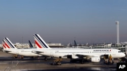 FILE - Air France planes are parked on the tarmac at Paris Charles de Gaulle airport, in Roissy, near Paris, Feb. 7, 2012.
