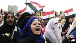 Egyptian anti-Mubarak protesters shout slogans as they march in Alexandria, Egypt, Saturday, Feb. 5, 2011