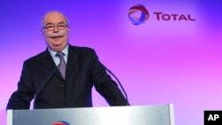 FILE - This Feb. 13, 2013 file photo shows French energy giant Total CEO, Christophe de Margerie, posing prior to a press conference in Paris, France.