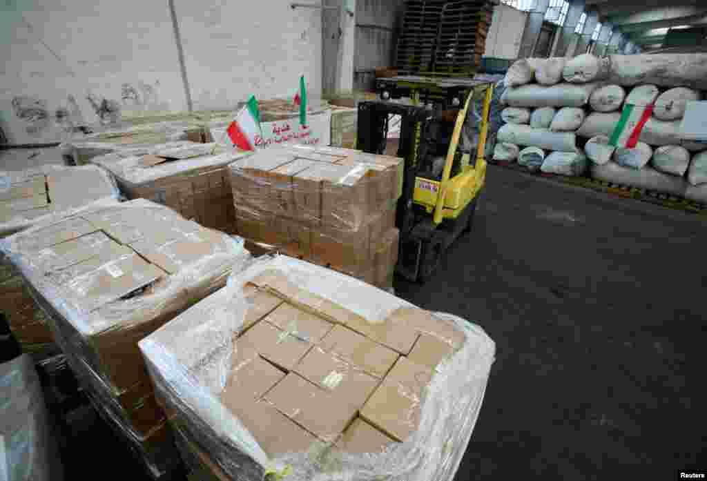 A forklift truck lifts boxes of Iranian humanitarian aid for Syrian refugees at the port of Beirut, January 23, 2013.