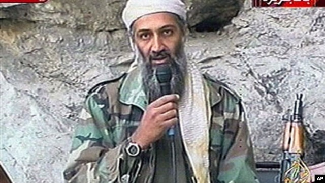 This image made from video broadcast on Sunday, Oct. 7, 2001 shows Osama bin Laden at an undisclosed location. Al-Qaida leader Osama bin Laden threatened in a new audio tape to kill French citizens to avenge their country's support for the U.S.-led war in