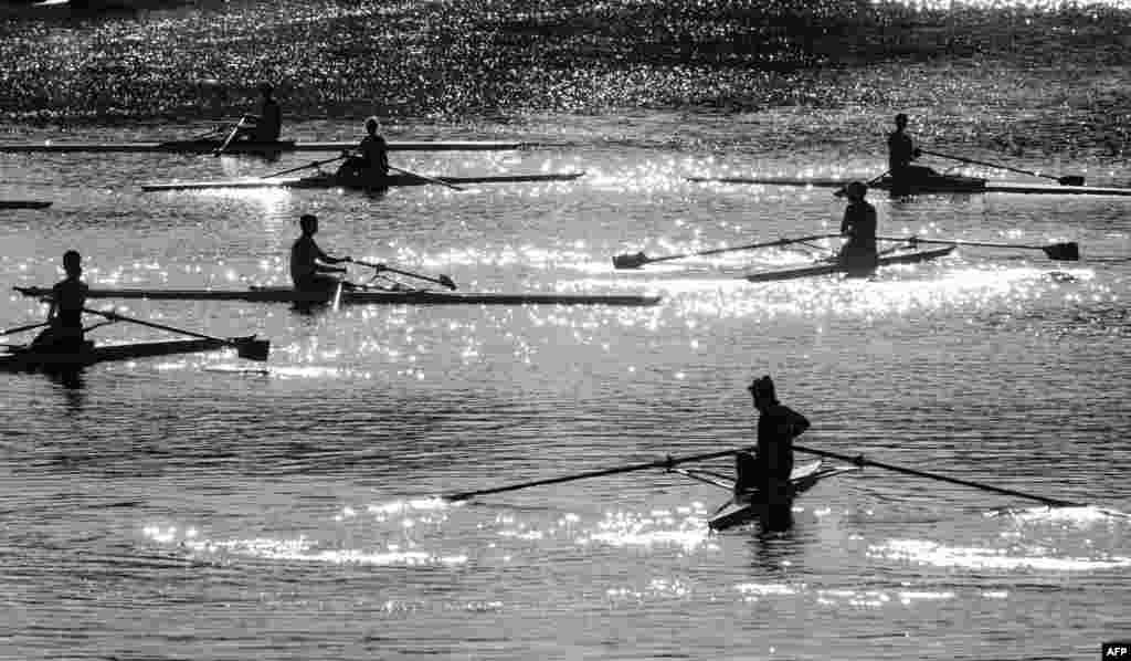 Rowers take part in a training session on the Isebek canal in Hamburg, Germany.
