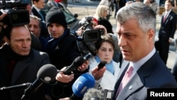 Kosovo's Prime Minister Hashim Thaci (R) talks to the media as he arrives for a meeting with Serbian Prime Minister Ivica Dacic (unseen) and European Union foreign policy chief Catherine Ashton (unseen) in Brussels, April 2, 2013.