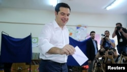 Greek Prime Minister Alexis Tsipras votes at a polling station in Athens, July 5, 2015.