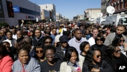 A large crowd forms near a stage where President Barack Obama will speak in Selma, Alabama.