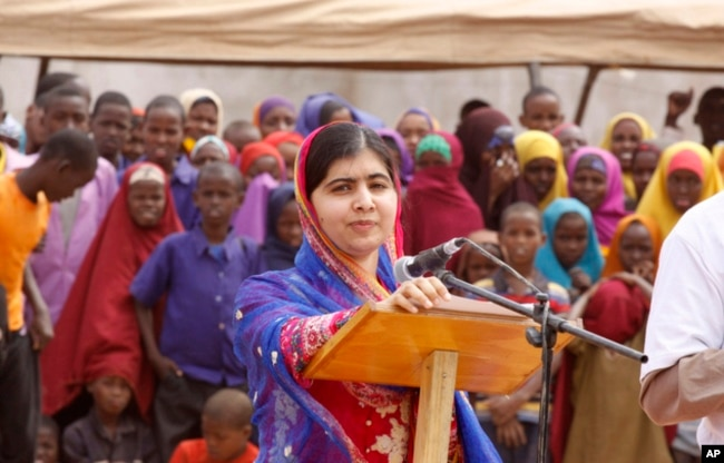 FILE - Malala Yousafza, speaks to refugees in the Dadaab refugee camp, Kenya, July 12, 2016.
