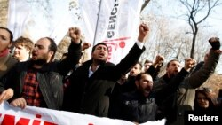Protesters shout slogans against Turkey's Prime Minister Tayyip Erdogan during a demonstration in Ankara, Feb. 6, 2014.