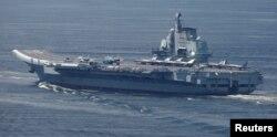 FILE - China's aircraft carrier Liaoning departs Hong Kong, China, July 11, 2017. REUTERS/Bobby Yip/File Photo
