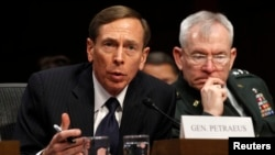 FILE - David Petraeus, former CIA director and four-star Army general, at a 2012 Senate hearing with Lieutenant General Ronald Burgess in Washington, D.C.