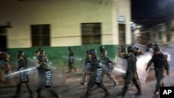 Military police patrols during government imposed dawn-to-dusk curfew in Tegucigalpa, Honduras, late Saturday, Dec. 2, 2017. The main opposition candidate called Saturday for Honduras' disputed presidential election to be held again after the country erupted in deadly protests over the delayed vote count.