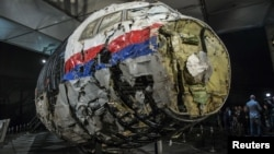 FILE - The reconstructed wreckage of the MH17 airplane is seen after the presentation of the final report into the crash of July 2014 of Malaysia Airlines flight MH17 over Ukraine, in Gilze Rijen, the Netherlands, Oct. 13, 2015.