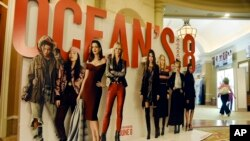 "An oversized movie advertisement for the upcoming film ""Ocean's 8,"" featuring an all-female starring cast, is pictured on day one of CinemaCon 2018, the official convention of the National Association of Theatre Owners, at Caesars Palace in Las Vegas, Apr"
