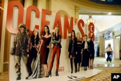 """An oversized movie advertisement for the upcoming film """"Ocean's 8,"""" featuring an all-female starring cast, is pictured on day one of CinemaCon 2018, the official convention of the National Association of Theatre Owners, at Caesars Palace in Las Vegas, April 23, 2018."""