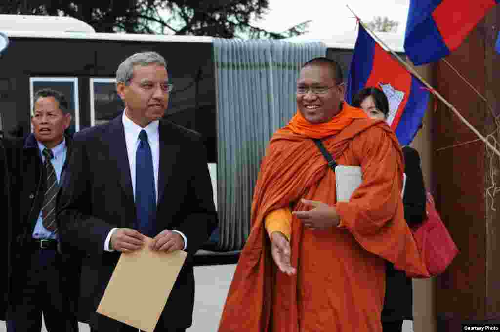 UN's human rights envoy to Cambodia, Surya Subedi, with Loun Sovath, a Buddhist monk and land rights activist. (Photo courtesy of SRP France)