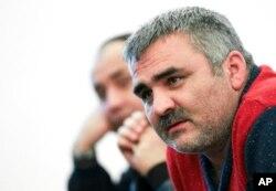 FILE - Independent Azerbaijani journalist Afgan Mukhtarli speaks in Baku, Azerbaijan, March 2, 2014.