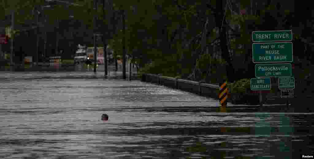 A man swims in a flooded street after the passage of Hurricane Florence in New Bern, North Carolina, Sept. 16, 2018.