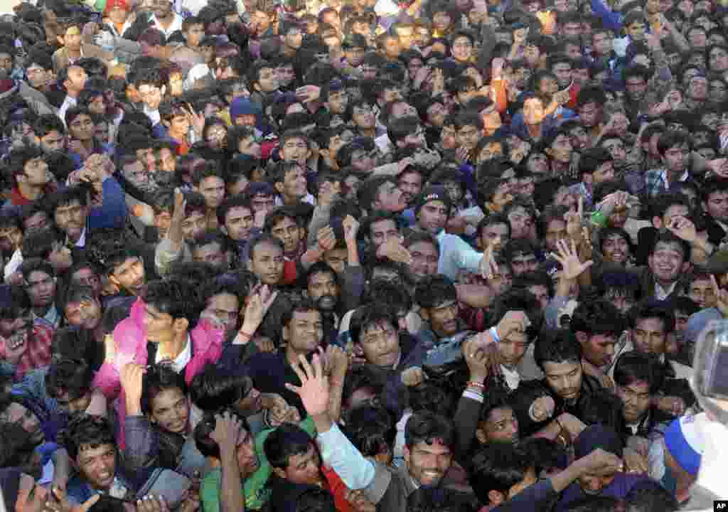 Indian cricket fans jostle for tickets for the second Twenty20 cricket match between India and Pakistan in Ahmadabad, India, December 26, 2012.