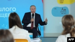 Russian President Vladimir Putin meets with teenagers to mark the start of the new school year in the Russian far eastern city of Vladivostok on Sept. 1, 2021. (Sputnik via AFP)