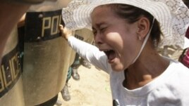 A Cambodian protester, right, from Boueng Kak lake, cries as she clashes with police officers in Phnom Penh, file photo.