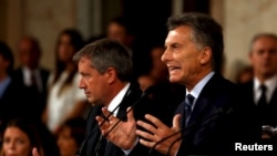 FILE - Argentina's President Mauricio Macri gestures as he speaks during the opening session of the 134th legislative term at the Congress in Buenos Aires, Argentina, March 1, 2016.