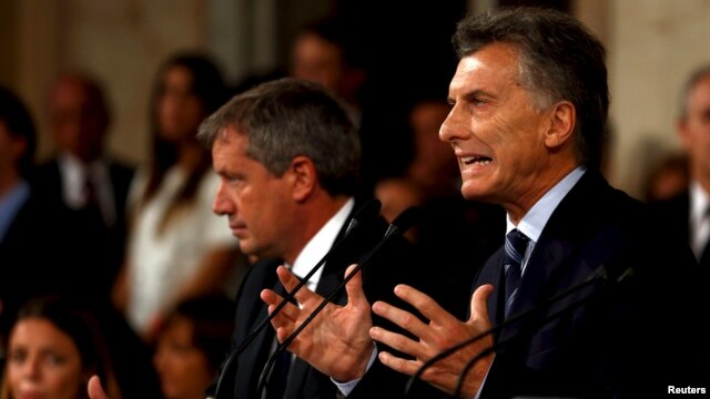 Argentina's President Mauricio Macri gestures as he speaks during the opening session of the 134th legislative term at the Congress in Buenos Aires, Argentina, March 1, 2016.
