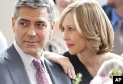 George Clooney and Vera Farmiga in scene from Up In The Air