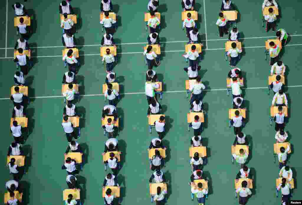 Students play Chinese chess during a school competition in Shenyang, Liaoning province, China.