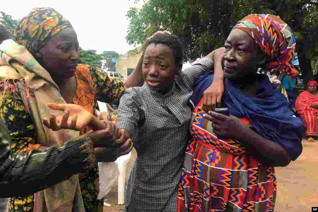 A student who was abducted and then released is reunited with her family at the Bethel Baptist High School in Damishi, Nigeria, July 25, 2021.
