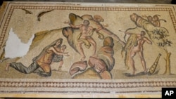 This undated photo provided by the U.S Department of Justice shows an ancient mosaic believed to have been looted from war-torn Syria and illegally imported into the United States.