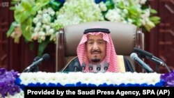 Saudi King Salman gives his annual policy speech in the ornate hall of the consultative Shura Council, Nov. 19, 2018, Riyadh, Saudi Arabia.