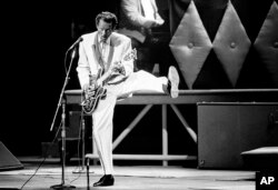 FILE - In this Oct. 17, 1986 file photo, Chuck Berry performs during a concert celebration for his 60th birthday at the Fox Theatre in St. Louis, Mo.