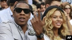 Rapper Jay-Z and his wife, singer Beyonce, attend the match between Novak Djokovic of Serbia and Rafael Nadal of Spain during the men's final of the U.S. Open tennis tournament in New York (file photo)