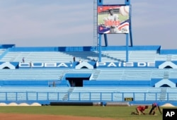 Workers are seen at the Latinoamericano baseball stadium ahead of an exhibition baseball game between the Cuban national team and the Tampa Bay Rays in Havana, Cuba, March 16, 2016.