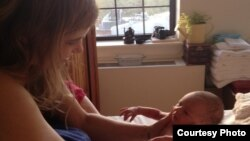 Emilie Jacobs holds her newborn after giving birth to her first baby at home. (Photo: Emilie Jacobs)