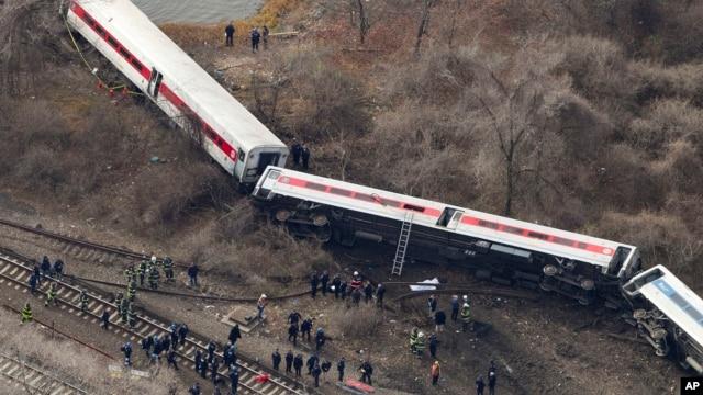 Emergency rescue personnel work the scene of a Metro-North passenger train derailment in the Bronx borough of New York, Dec. 1, 2013.