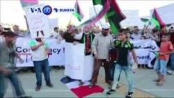 VOA60 DUNIYA: LIBYA Daruruwan Mutane a Tripoli Sun yi Zanga Zangar Nuna Adawa da Kasancewar Dakarun Faransa a Kasar.