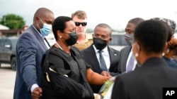 In this handout photo released by Haitian officials, Haiti's first lady, Martine Moise, her right arm in a sling, arrives at the Toussaint Louverture International Airport, in Port-au-Prince, July 17, 2021.