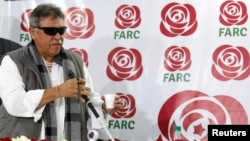 Colombia's Marxist FARC Jesus Santrich gestures during a news conference in Bogota, Colombia, Nov. 16, 2017.