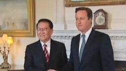 英国首相敦促彻底调查伍德案