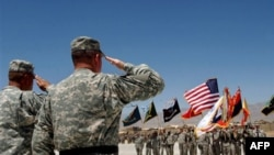 U.S. military officers salute their color guards during a ceremony marking the U.S. Army's 231st birthday at the U.S main base in Bagram, north of Kabul, Afghanistan on Wednesday, June 14, 2006. The Continental Congress had created the United States Army