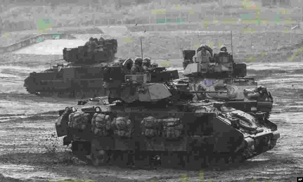 U.S. armored vehicles move during military exercises in Paju near the border with North Korea, South Korea, April 25, 2013.