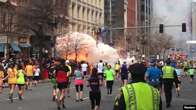 Runners continue towards the finish line of the Boston Marathon on April 15, 2013.  REUTERS/Dan Lampariello