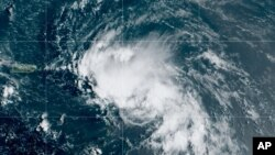 This satellite image released by the National Oceanic and Atmospheric Administration (NOAA) shows Tropical Storm Laura in the North Atlantic Ocean, Friday, Aug. 21, 2020. Laura formed Friday in the eastern Caribbean and forecasters said it poses a…
