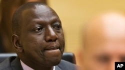 FILE - Kenya's Deputy President William Ruto awaits the start of his trial, Sept. 10, 2013.