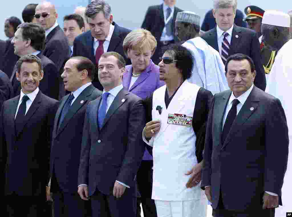 Libyan leader Moammar Gadhafi is seen during a group photo at the G8 summit in L'Aquila, Italy, July 10, 2009. (AP)