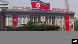North Korean vehicle carrying a missile passes by during a mass military parade to celebrate the centenary of the birth of late N. Korean founder Kim Il Sung, April 15, 2012.