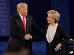Republican presidential nominee Donald Trump shakes hands with Democratic presidential nominee Hillary Clinton following the second presidential debate at Washington University in St. Louis, Oct. 9, 2016.