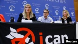 FILE - Beatrice Fihn, executive director of the International Campaign to Abolish Nuclear Weapons (ICAN), and other members of the organization attend a news conference after ICAN won the Nobel Peace Prize 2017, in Geneva, Switzerland, Oct. 6, 2017.
