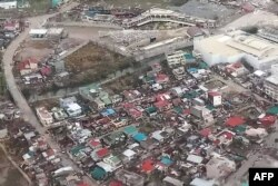 This handout photo taken and received from the Philippine Coast Guard on November 2, 2020 shows an aerial view of damaged buildings on the island province of Catanduanes, in the aftermath of Typhoon Goni.